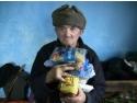 lemne de foc. Doneaza lemne de foc și alimente pentru bătrânii săraci și neputincioși