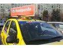 caseta luminoasa. Publicitate Taxi Bucuresti, campanie foodpanda.ro