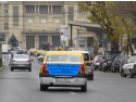 banner publicitar. Evia Media, publicitate neconventionala pe taxi