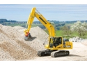 the gingerbread house. Komatsu HB215LC - excavator cu actionare hidraulica