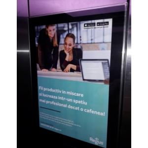 lucru. Publicitate in lifturile cladirilor de birouri